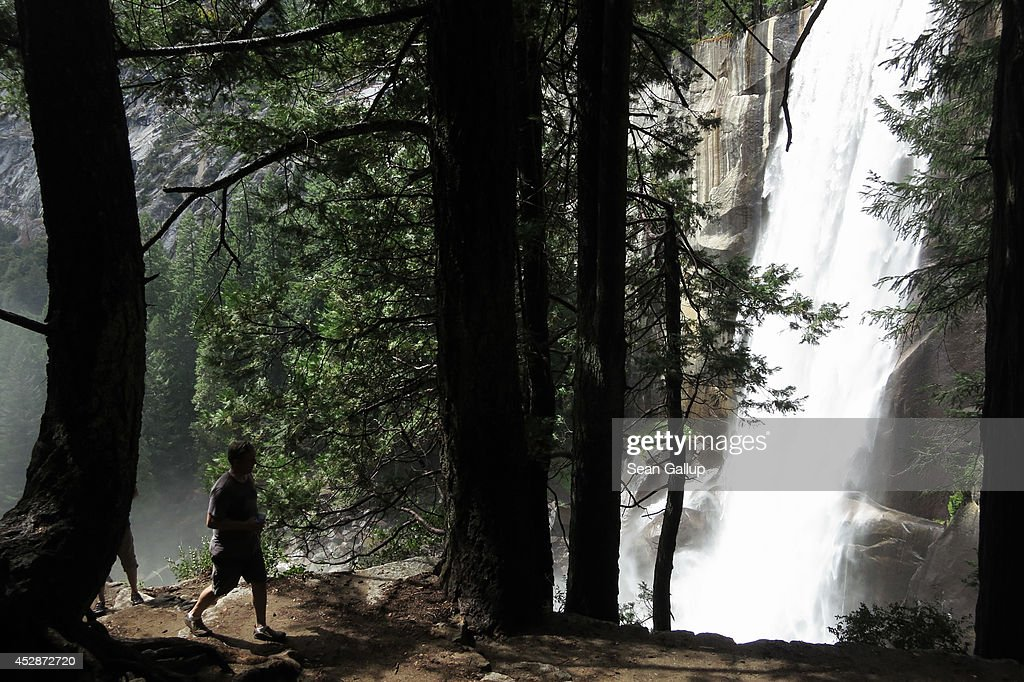 Visitors hike the Vernal Fall trail on July 21, 2014 in Yosemite National Park, California. Yosemite is among California's biggest tourist destinaitons.