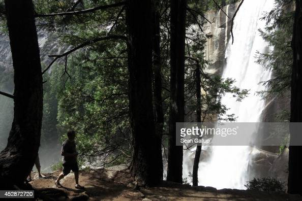 Visitors hike the Vernal Fall trail on July 21 2014 in Yosemite National Park California Yosemite is among California's biggest tourist destinaitons