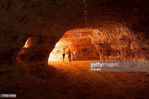 Visitors in a broad opal mine shaft Andamooka South Australia Australia