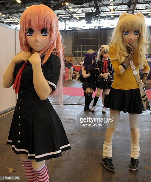 Visitors in anime/manga cosplay are pictured at the Japan Expo 2015 exhibition devoted to Japanese culture and entertainment on July 3 2015 in...