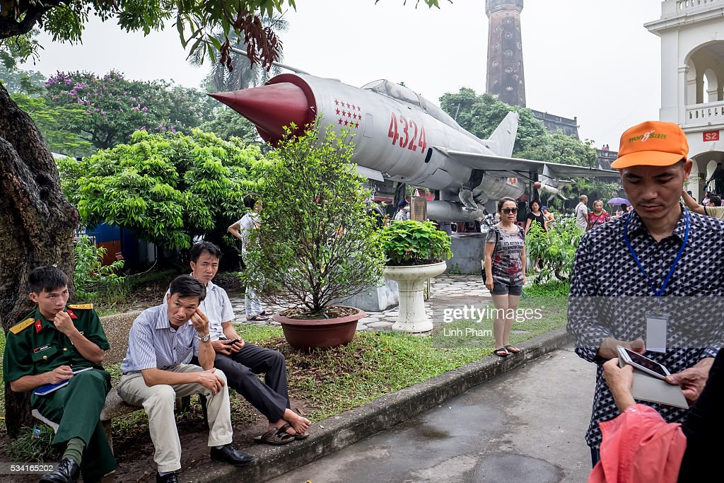 Visitors in front of a model of an airplane at Vietnam Military History Museum on May 25, 2016 in Hanoi, Vietnam. U.S. President Obama made his historic visit to Vietnam on May 23 with an aim to strengthen the strategic and economic relationship between both countries four decades after the Vietnam war. During the visit, Obama announced the U.S. will fully lift its embargo on weapons and raised issues related to human rights while speaking to the youths on freedom of expression.