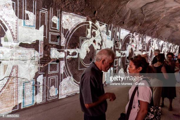 Visitors in front of a wall bearing a projection in the Criptoportico Neroniano a tunnel in the Palatino Hill in the Ancient Roman Forum during a...
