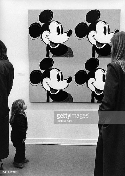 Visitors in front of the 'Mickey Mouse' of Andy Wahrol in the exhibition 'Andy Warhol Bilder 19611981' in the Lenbachhaus in Munich 1982