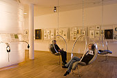 Visitors in listening pods in Bachhaus Bach House Museum.