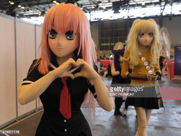 Visitors in manga cosplay pose at the Japan Expo 2015 exhibition devoted to Japanese culture and entertainment on July 3 2015 in Villepinte near...