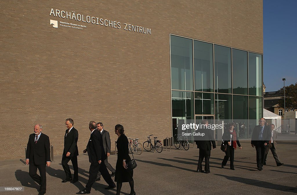 Visitors, including Michael Eissenhauer (2nd from L), General Director of the State Museums of Berlin, and Hermann Parzinger (4th from L), President of the Prussian Cultural Heritage Foundation, walk outside the new Archaeology Center (Archaeologische Zentrum) on October 31, 2012 in Berlin, Germany. The center, which houses archives, research, laboratory and restoration faicilites, will serve the city's five archaeological museums. Germany has a rich history of leading archaeological excavations across the globe.