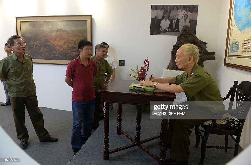 Visitors including veterans look at a silicon life-size statue of late General Vo Nguyen Giap whose troops defeated French at Dien Bien Phu battlefield in 1954, at an exhibition held at Hanoi's Army Museum on April 29, 2014. Vietnam will celebrate next week the 60th anniversary of the Dien Bien Phu battle.