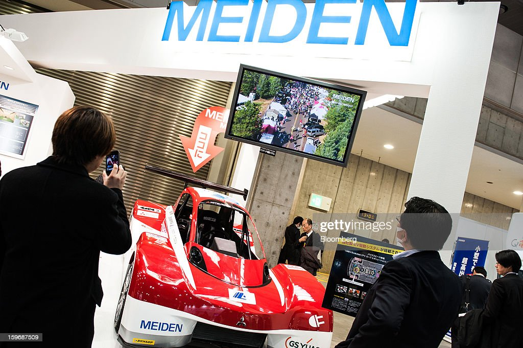 Visitors inspect a Mitsubishi Innovative Electric Vehicle (MiEV) Evolution vehicle at the Meidensha Corp. booth at Automotive World 2013 in Tokyo, Japan, on Friday, Jan. 18, 2013. The Automotive World 2013 trade show ends today. Photographer: Noriko Hayashi/Bloomberg via Getty Images