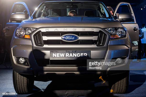 visitors inspect a new ford ranger 2015 pickup truck on display during the ford motor co