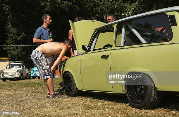 Visitors inspect a Trabant automobile at a Trabant enthusiasts' weekend on August 8 2015 near Nossen Germany The Trabant also called the Trabi is the...