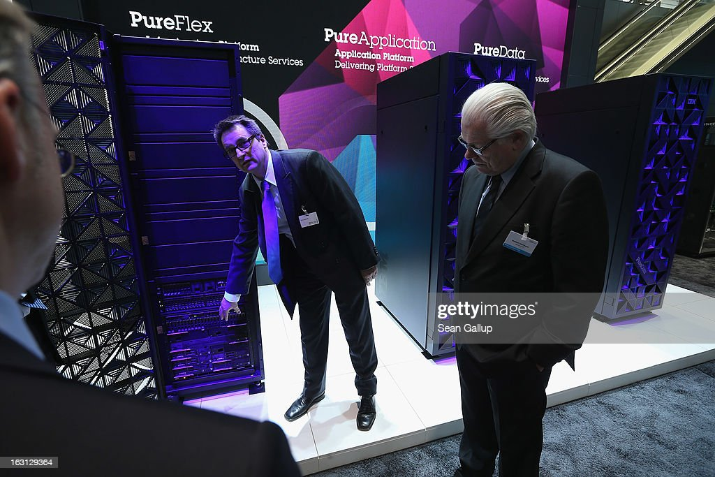 Visitors inspect advanced server towers at the IBM stand at the 2013 CeBIT technology trade fair on March 5, 2013 in Hanover, Germany. CeBIT will be open March 5-9.