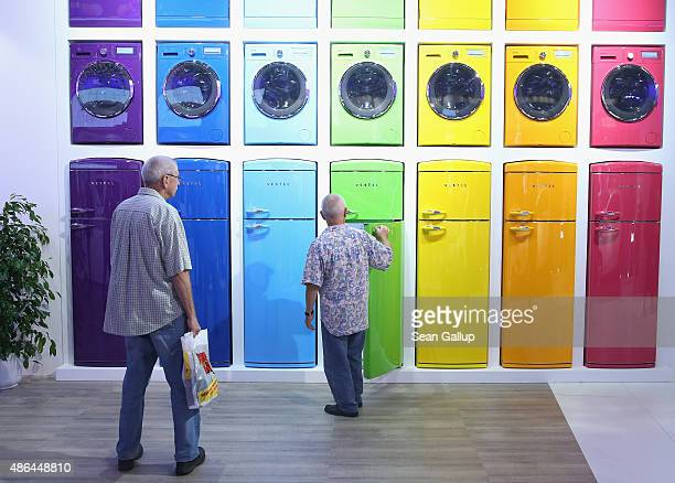 Visitors inspect an array of home appliances including refrigerator in a retrolook at the Vestel stand at the 2015 IFA consumer electronics and...