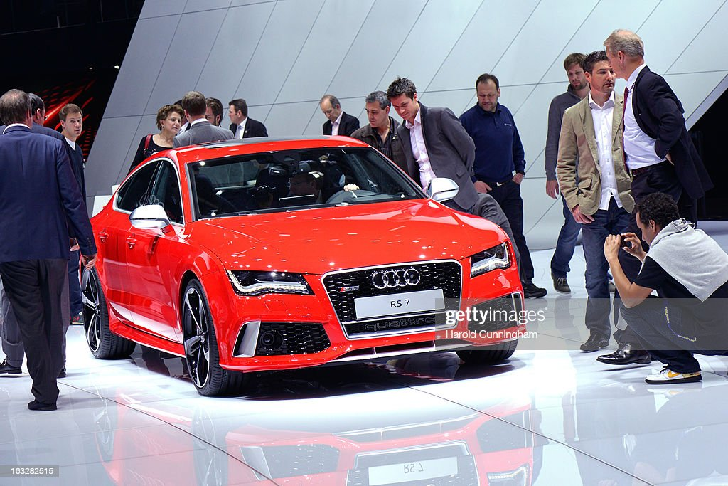 Visitors inspect an Audi Quattro RS7 during the 83rd Geneva Motor Show on March 6, 2013 in Geneva, Switzerland. Held annually with more than 130 product premiers from the auto industry unveiled this year, the Geneva Motor Show is one of the world's five most important auto shows.
