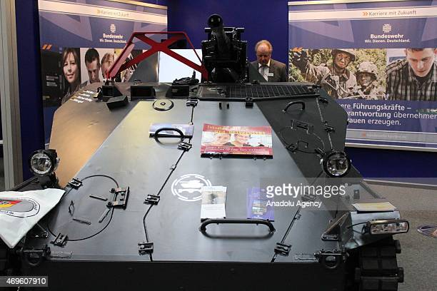 Visitors inspect an industrial equipment during Hannover Messe industrial fair 2015 on April 13 2015 in Hannover Germany Hannover Messe industrial...