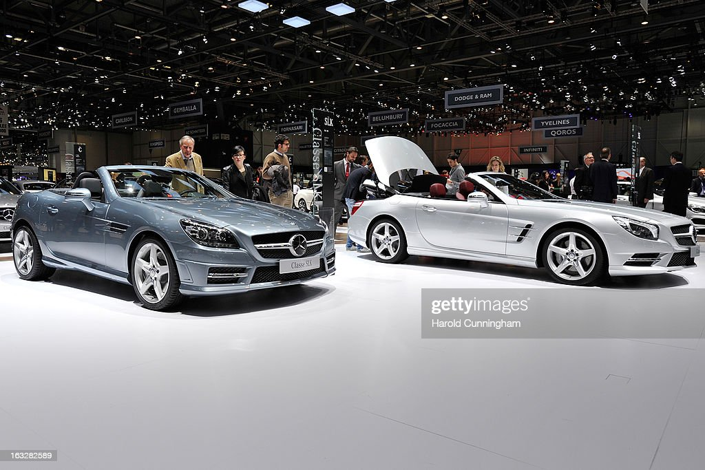 Visitors inspect Mercedes-Benz convertible cars during the 83rd Geneva Motor Show on March 6, 2013 in Geneva, Switzerland. Held annually with more than 130 product premiers from the auto industry unveiled this year, the Geneva Motor Show is one of the world's five most important auto shows.