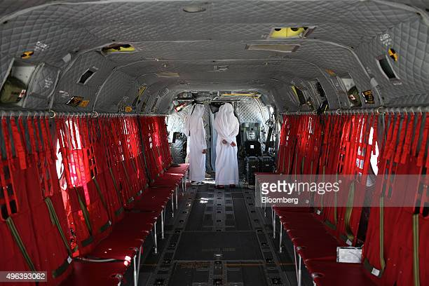 Visitors inspect the interior of a Chinook military helicopter manufactured by Boeing Co on the second day of the 14th Dubai Air Show at Dubai World...