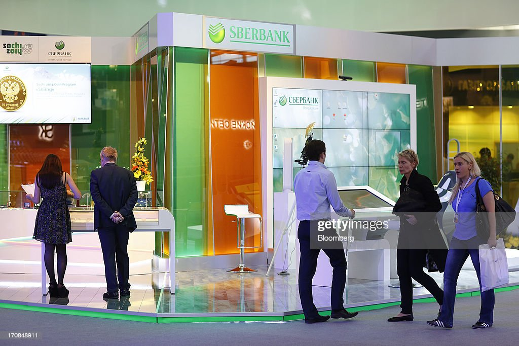 Visitors inspect the OAO Sberbank pavilion ahead of the St. Petersburg International Economic Forum 2013 (SPIEF) in St. Petersburg, Russia, on Wednesday, June 19, 2013. The Russian Deputy Prime Minister Igor Shuvalov told the conference that the country's World Trade Organization accession negotiations could be further delayed unless several remaining disputed matters are solved. Photographer: Simon Dawson/Bloomberg via Getty Images