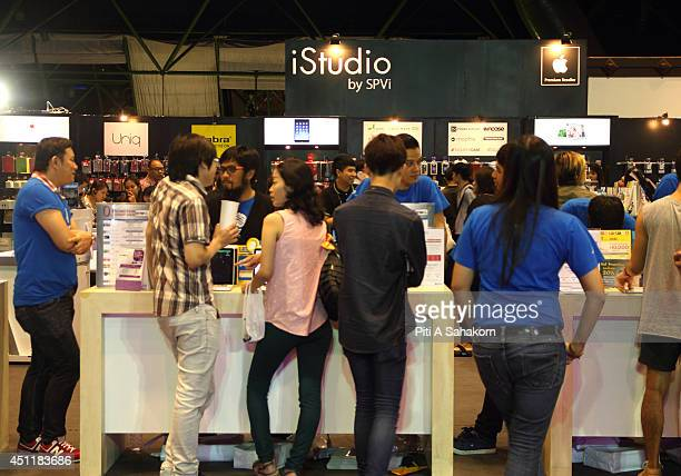 Visitors inspects Mac Book lop top at the Commart NextGen 2014 in Bangkok One of the most comprehensive events for new technology and innovative IT...