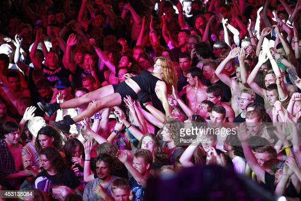 Visitors join during the third day of a so called 'Woodstock Stop' festival in the Polish town of Kuestrin A three day openair music festival free...