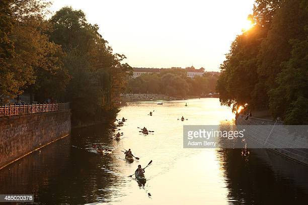 Visitors kayak down the Landwehrkanal in the Kreuzberg district of the city on August 23 2015 in Berlin Germany Rainy weather is expected early in...
