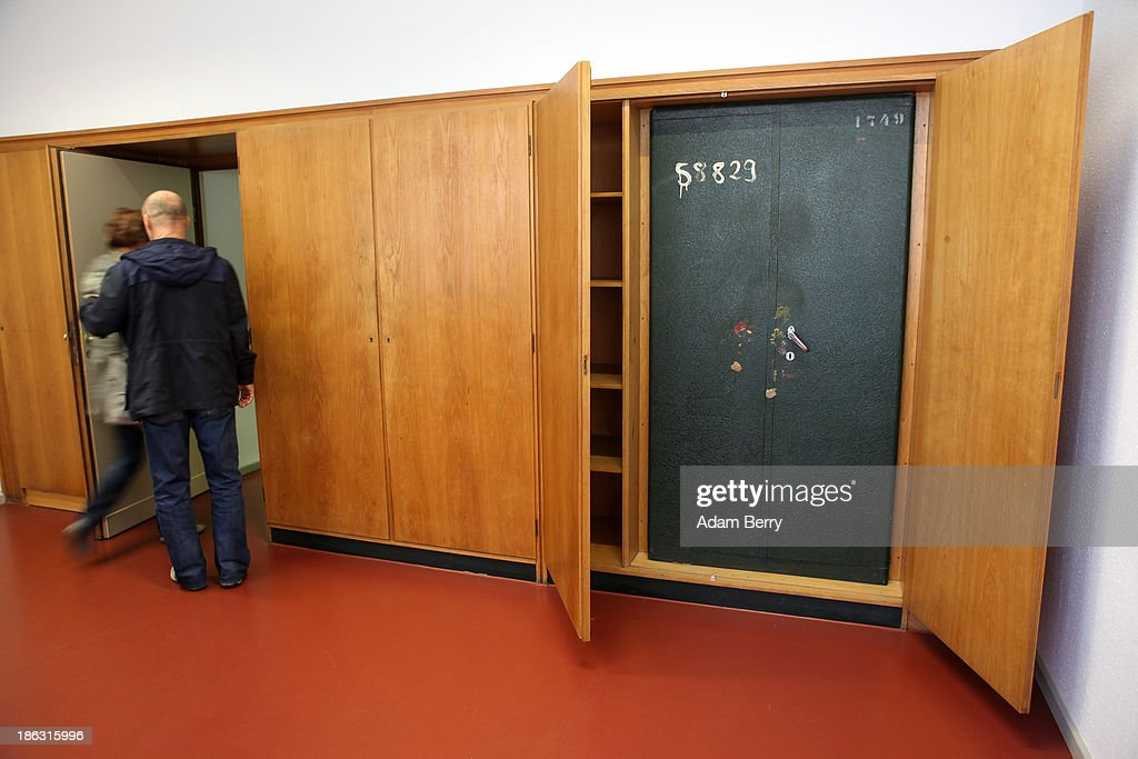 Visitors leave a room featuring a fireproof safe in a cabinet at the Stasi (Staatssicherheit), or East German Secret Police Museum, on October 30, 2013 in Berlin, Germany. German officials have maintained that they had strong evidence indicating that the American Nation Security Agency (NSA) has eavesdropped on Chancellor Angela Merkel's mobile phone, surveillance that the U.S. has since claimed is essential to its security operations and is standard procedure. The charge has caused a furor among political leaders across Europe, but is particularly troublesome to those who, like Merkel, grew up in the former East Germany and have recent memories of being spied upon by their own government. In response to anger over the matter from Germany, Mexico, France, Spain and Brazil ,the U.S. Senate Intelligence committee is currently conducting a major review of such surveillance operations, while the NSA insists that any such data collected on ordinary citizens turned over to the agency had been conducted by the local allied governments themselves.