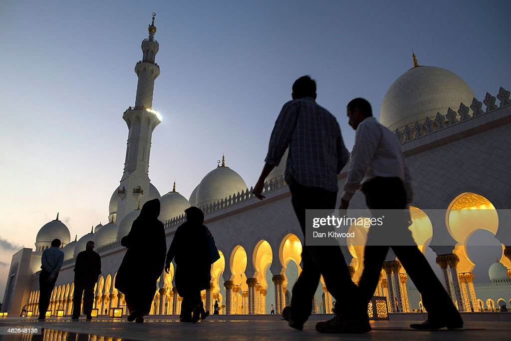 Visitors leave the Sheikh Zayed Grand Mosque on February 1 2015 in Abu Dhabi United Arab Emirates Abu Dhabi's Sheikh Zayed Grand Mosque was built...