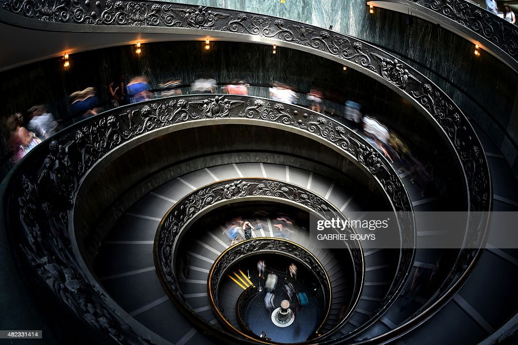Visitors leave the Vatican Museums at the Vatican on July 30 using the spiral stairs designed by Giuseppe Momo in 1932 AFP PHOTO / GABRIEL BOUYS /...