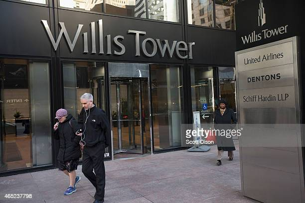 Visitors leave the Willis Tower once known as the Sears Tower on March 4 2015 in Chicago Illinois The building completed in 1973 was the world's...