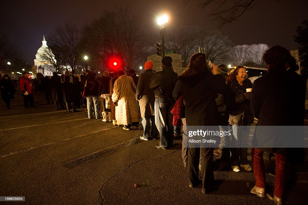 Visitors line up at the Blue Gate before sunrise on Inauguration day for U.S. President Barack Obama at the U.S. Capitol building January 21, 2013 in Washington D.C. President Obama will be ceremonially sworn in for his second term today.