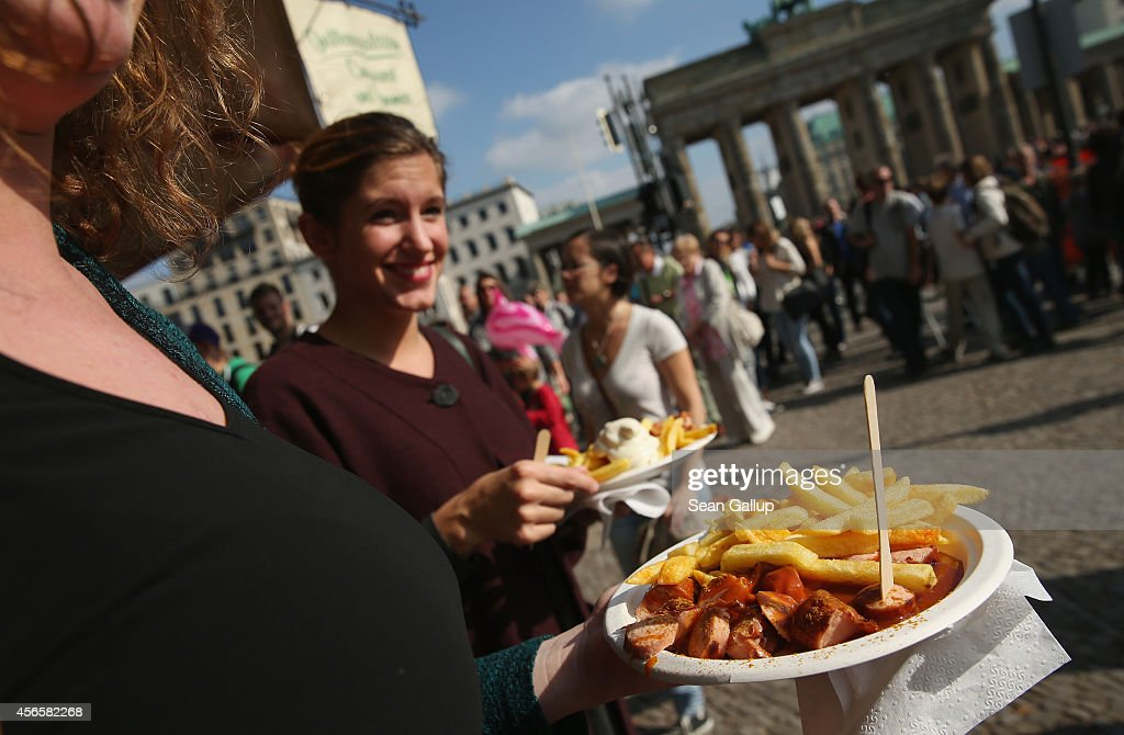 Visitors line up to buy currywurst and french fries on German Unity Day (Tag der Deutschen Einheit) near the Brandenburg Gate on October 3, 2014 in Berlin, Germany. Germany is celebrating the 24th anniversary of the day when former West Germany and East Germany reunited into modern Germany in 1990 following the end of the Cold War. This year Germany will also celebrate the 25th anniversary of the fall of the Berlin Wall that heralded the collapse of communist authority in East Germany.