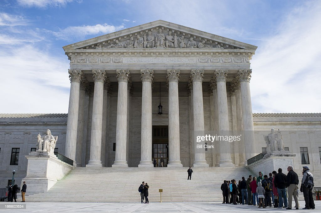 Visitors line up to enter the U.S. Supreme Court on Monday, Nov. 4, 2013.