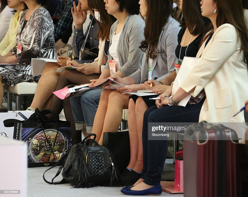 Visitors listen to a speaker during a demonstration at the Beautyworld Japan fair in Tokyo, Japan, on Monday, May 19, 2014. The business-to-business trade fair hosted by Messe Frankfurt is held through May 21. Photographer: Tomohiro Ohsumi/Bloomberg via Getty Images