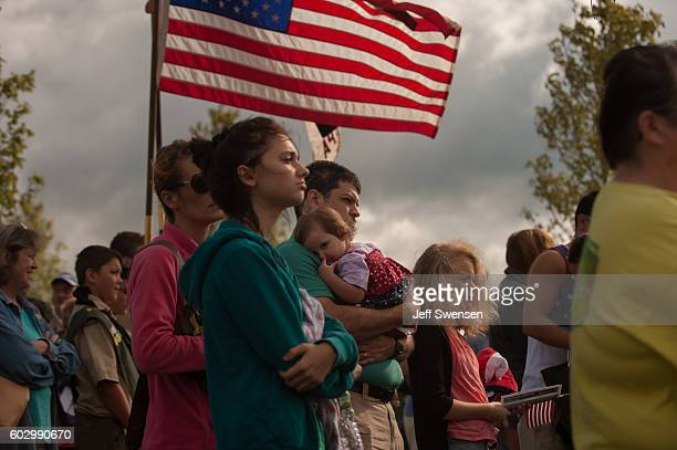 Visitors listen to speakers at the Flight 93 National Memorial during the 15th Anniversary ceremony of the September 11th terrorist attacks September...