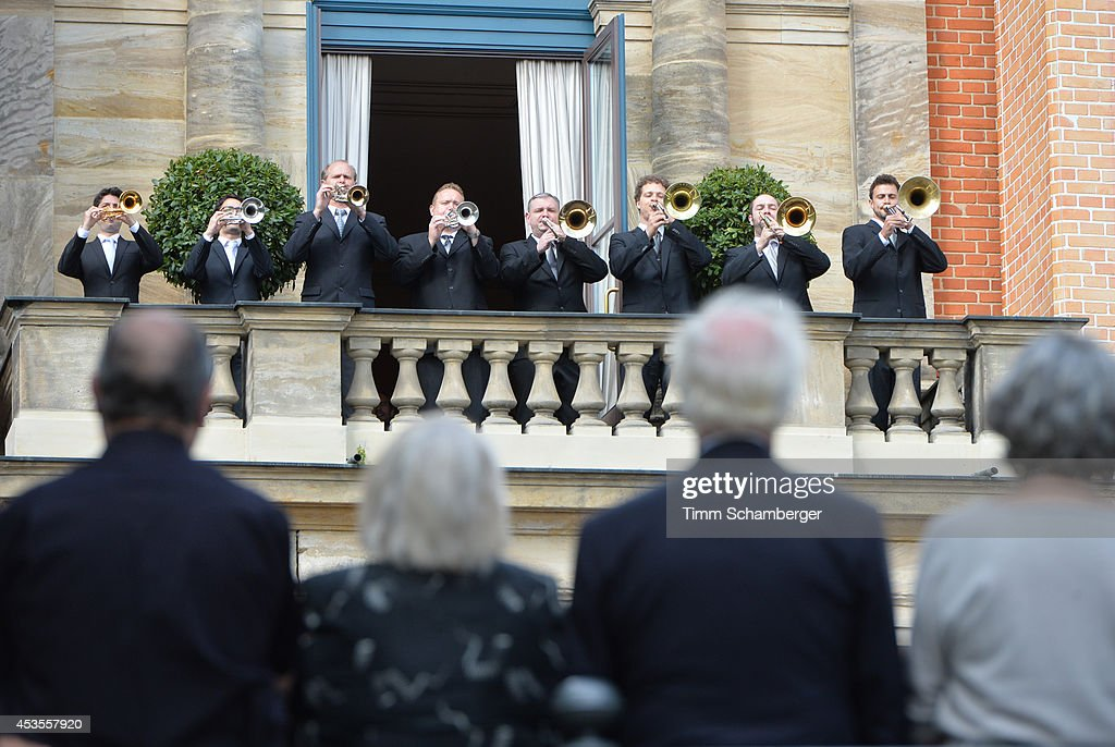 Visitors listen to the Fanfare at Bayreuth Festival Theatre on August 12 2014 in Bayreuth Germany