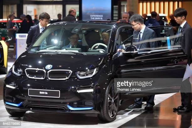 Visitors look a BMW I3s at the 2017 Frankfurt Auto Show 'Internationale Automobil Ausstellung' on September 13 2017 in Frankfurt am Main Germany The...
