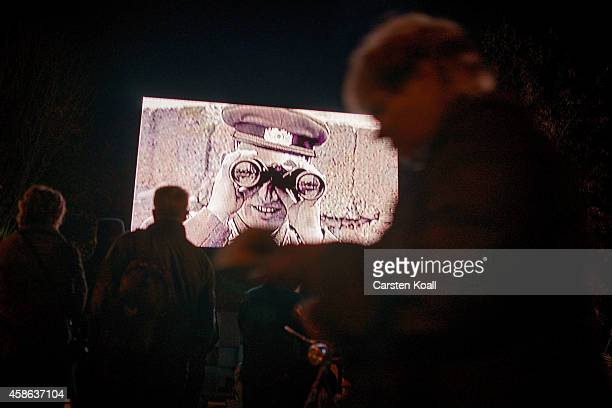 Visitors look a documentary about the WAll in Mauerpark a day before the 25th anniversary of the fall of the Wallon November 8 2014 in Berlin Germany...