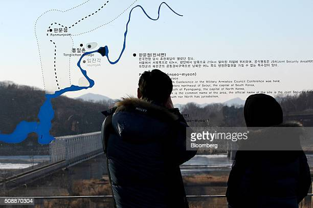 Visitors look across to the north side of the border in front of a map showing the demilitarized zone area at the Imjingak pavilion near the DMZ in...