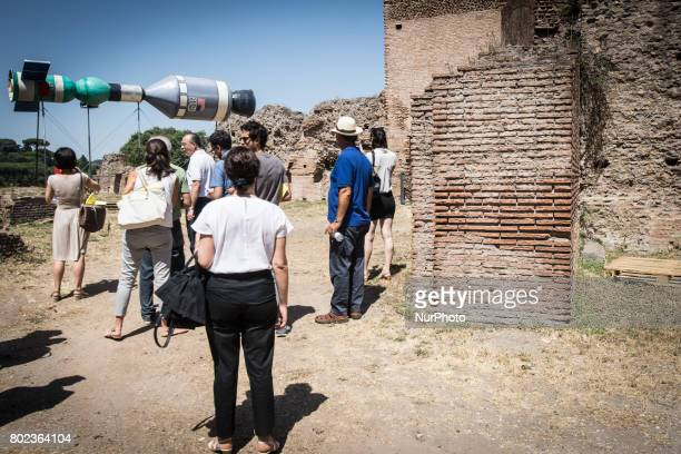 Visitors look an installation by artist Christian Philipp Muller titled quotSpace randezvousquot on June 27 2017 at the Palatine Hill in Rome during...
