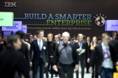 Visitors look arround at the IBM stand at the 2014 CeBIT technology Trade fair on March 10 2014 in Hanover Germany CeBIT is the world's largest...