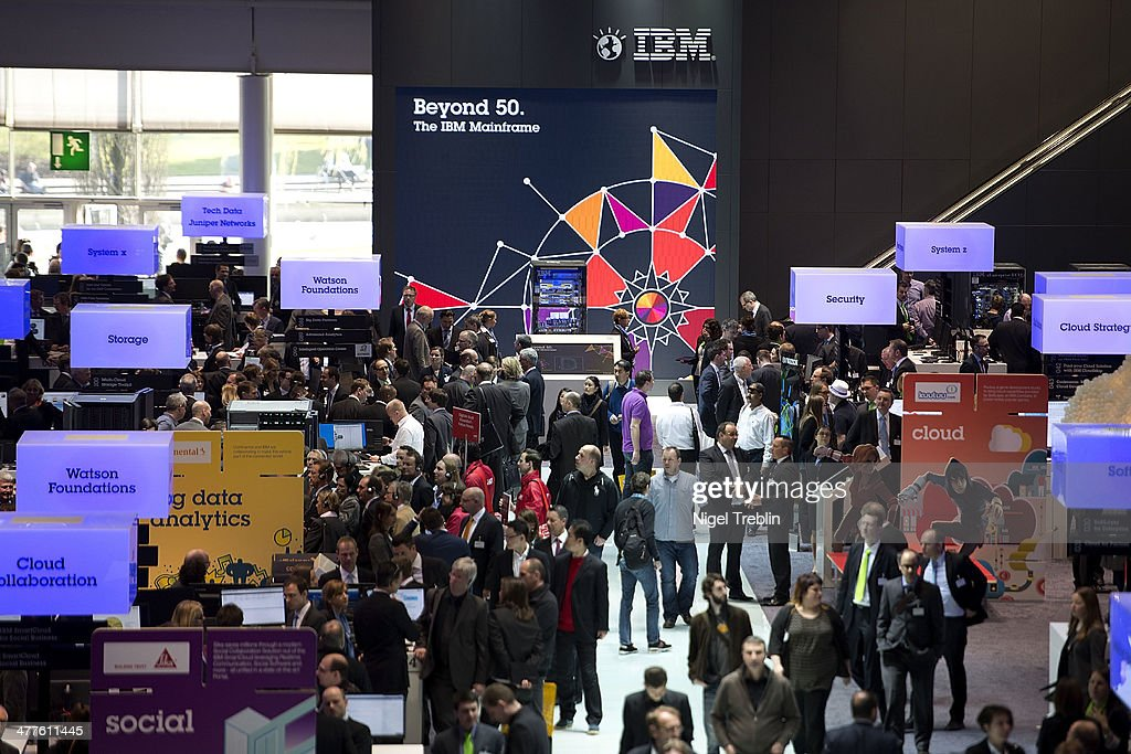Visitors look arround at the IBM stand at the 2014 CeBIT technology Trade fair on March 10, 2014 in Hanover, Germany. CeBIT is the world's largest technology fair and this year's partner nation is Great Britain.