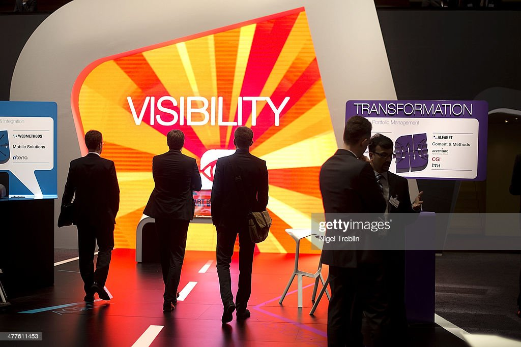 Visitors look arround at the Software AG stand at the 2014 CeBIT technology Trade fair on March 10, 2014 in Hanover, Germany. CeBIT is the world's largest technology fair and this year's partner nation is Great Britain.