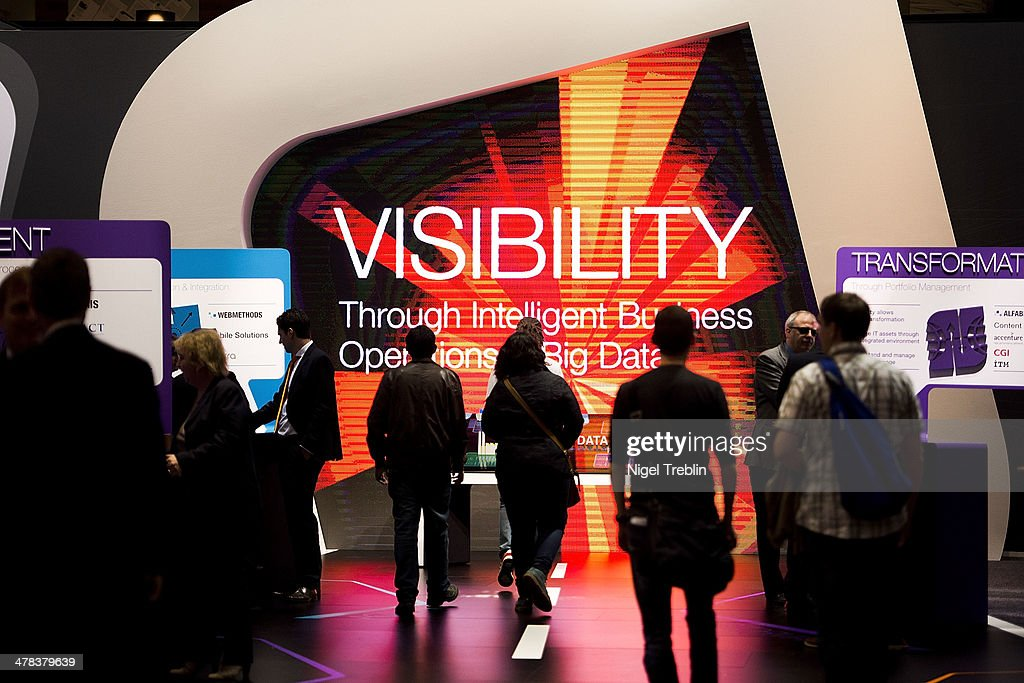 Visitors look arround at the Software AG stand at the 2014 CeBIT technology Trade fair on March 13, 2014 in Hanover, Germany. CeBIT is the world's largest technology fair and this year's partner nation is Great Britain.
