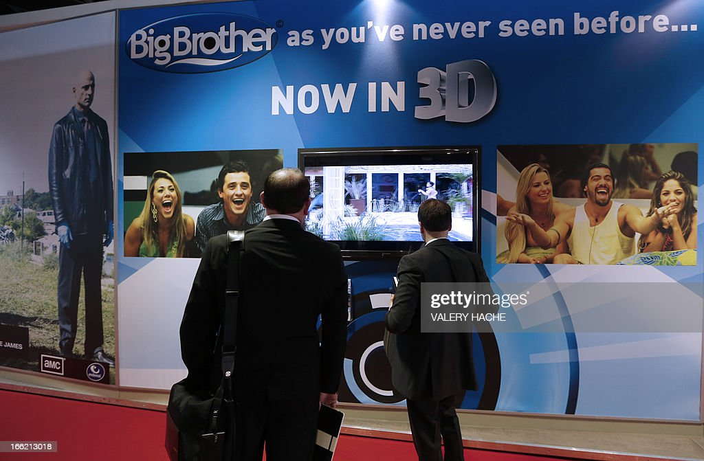 Visitors look at 3D television, on April 10, 2013 in Cannes, southeastern France, during the MIPTV, one of the world's largest broadcasting and audio-visual trade show.