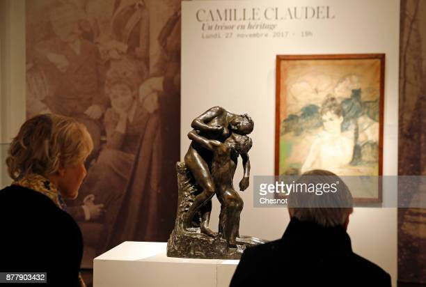 Visitors look at a bronze sculpture entitled 'L'abandon' by late French artist Camille Claudel at Artcurial auction house on November 23 2017 in...