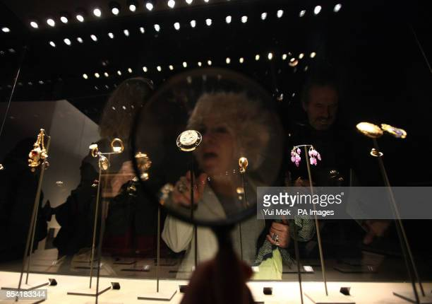 Visitors look at a display cabinet of jewellery including a cameo of Elizabeth I with a sieve from about 157985 on display at the Treasures of the...