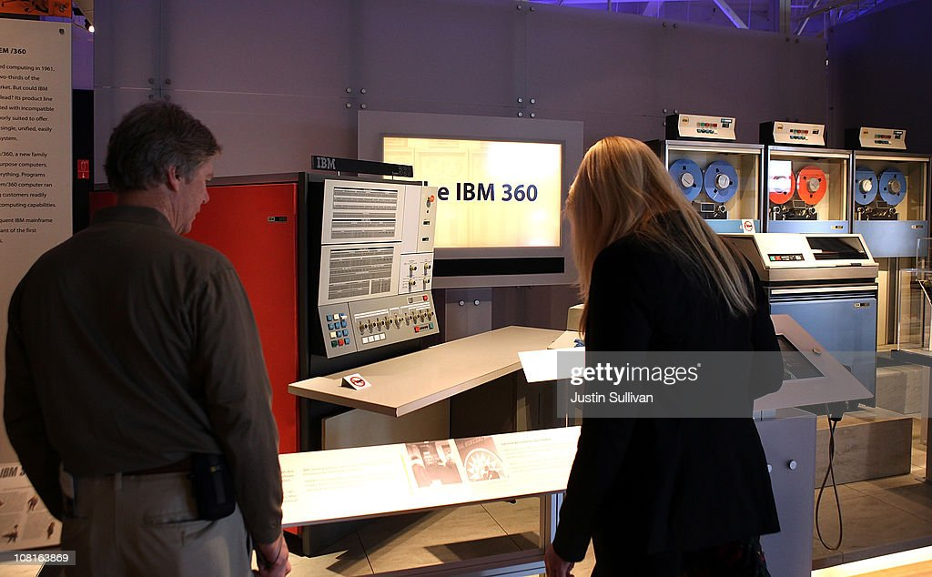 Visitors look at a display featuring a vintage IBM 360 cmputer and accessories at the Computer History Museum on January 19, 2011 in Mountain View, California. After a two year, $19 million renovation, the Computer History Museum re-opened its doors with a new 25,000 square foot exhibit called Revolution: The First 2000 Years of Computing. The exhibit features over 1,000 artifacts and 100 multimedia stations that explores every major aspect of the history of computing, from the abacus to the smart phone, and every step in between.