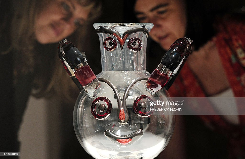 Visitors look at a glass sculpture entitled 'Gufo' made in 1962 by Italian artist Egidio Costantini with the collaboration of Pablo Picasso, on June 20, 2013 in the Lalique Museum in Wingen-sur-Moder, eastern France, before the opening day of the exhibition 'Le verre et les grands maitres de l'art moderne' (Glass and masters of modern art). The event will run from June 21 till November 3, 2013.