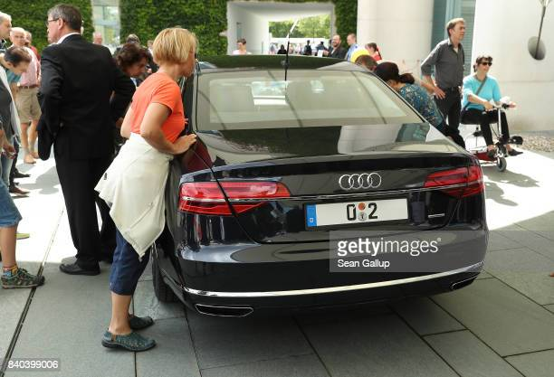 Visitors look at a government limousine during openhouse day at the Chancellery on August 27 2017 in Berlin Germany Germany faces federal elections...