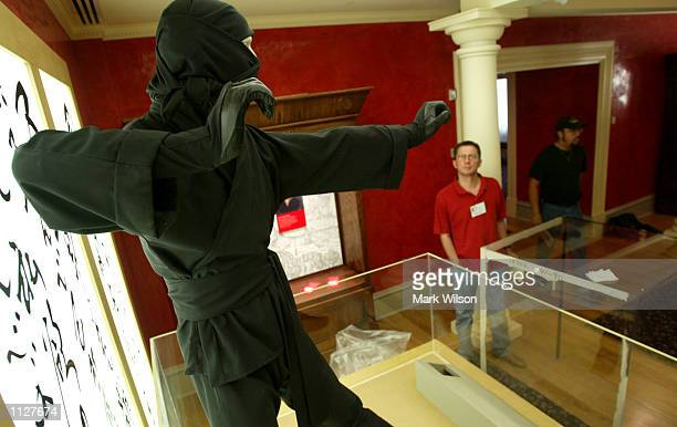 Visitors look at a Japanese Ninja one of the many exhibits at the International Spy Museum July 16 2002 in Washington DC The 68000 squarefoot museum...