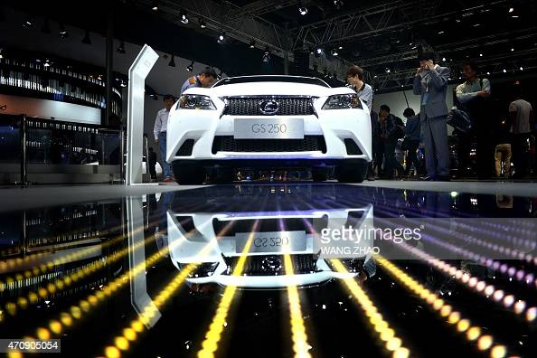 Visitors look at a Lexus GS250 during the 16th Shanghai International Automobile Industry Exhibition in Shanghai on April 24 2015 The vast majority...